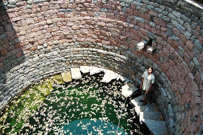 Student standing inside an Open Well